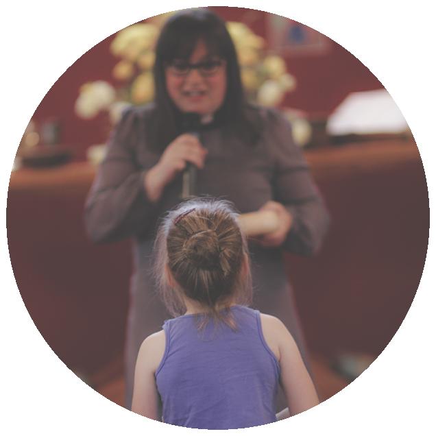 Girl Talking To Preacher During Worship